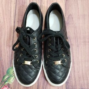 Guess black and gold sneakers